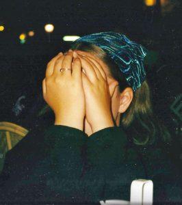 Emily hiding her face